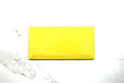 Biselado-brillo-amarillo-10x20